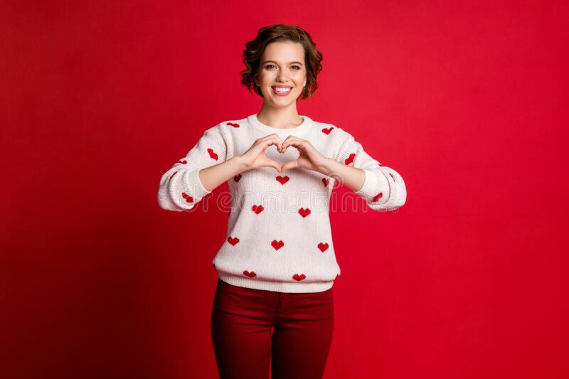 Portrait of positive cheerful girlfriend celebrate 14-february date show chest hands heart passionate lover sign wear. Portrait of positive cheerful girlfriend stock photography
