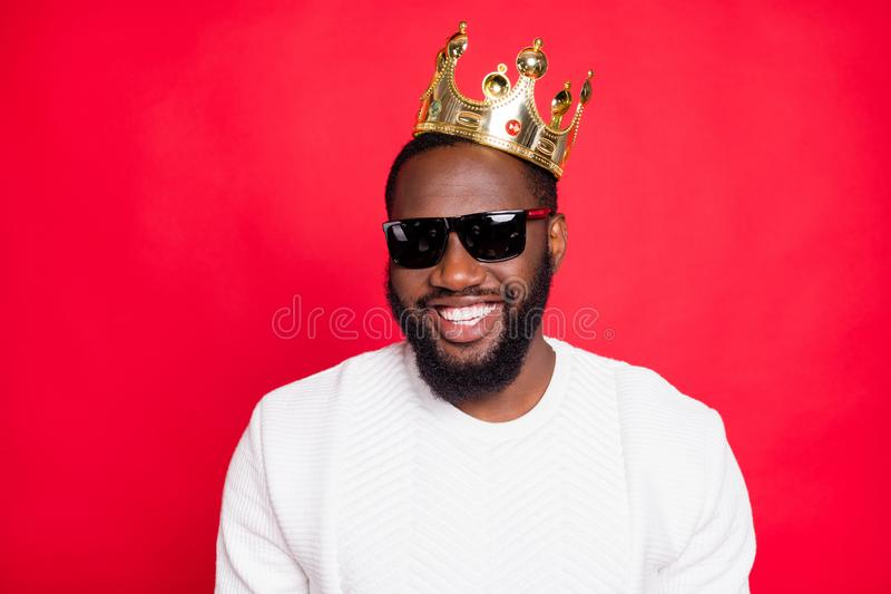 Portrait of positive cool afro american brown hair beard guy millionaire in eyewears look feel arrogant egocentric wear. Gold diadem, king style clothes royalty free stock image
