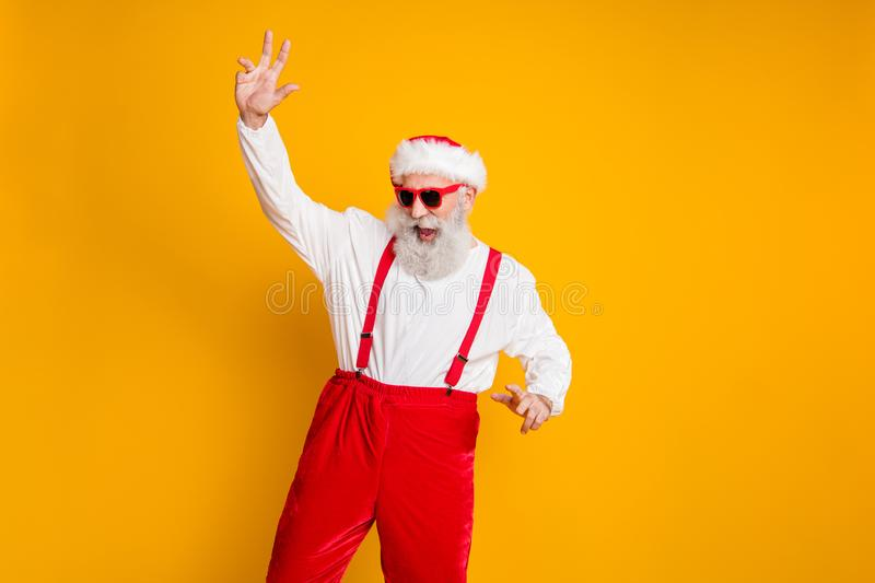 Portrait of positive funny santa claus hipster in red hat enjoy christmas party event fun newyear celebration dance club stock image