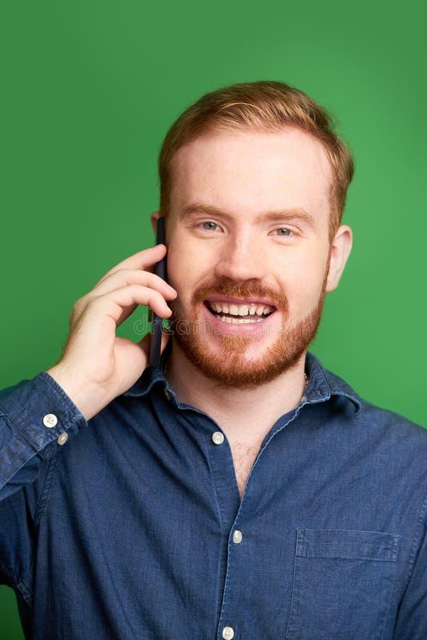 Irish young man making phone call stock photos