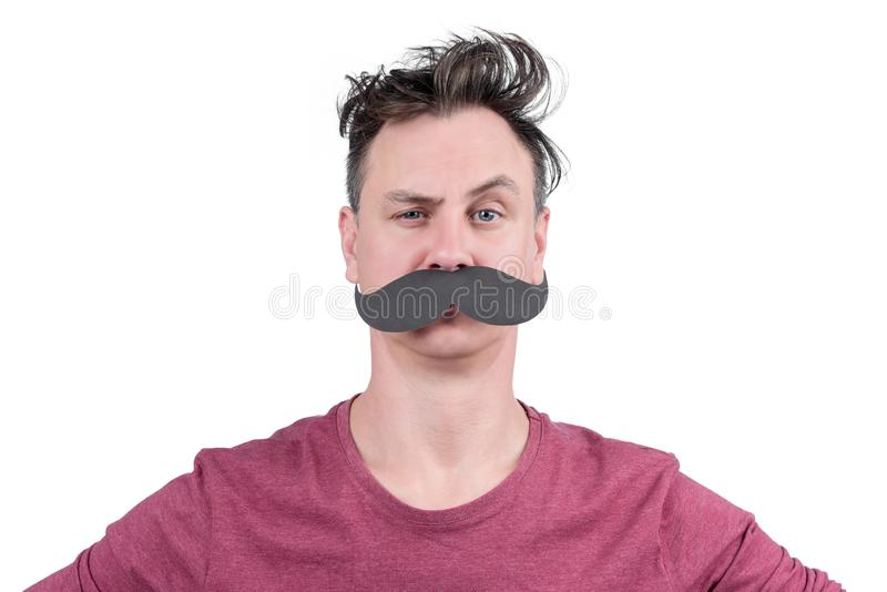 Portrait of a positive man with cardboard mustache and arched eyebrow, isolated on white background royalty free stock photos