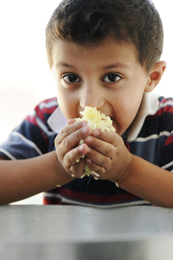 Portrait of poverty, little poor boy royalty free stock image