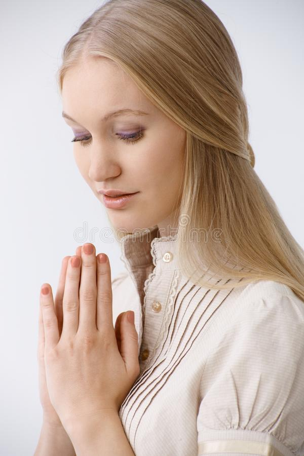Portrait of praying woman stock image