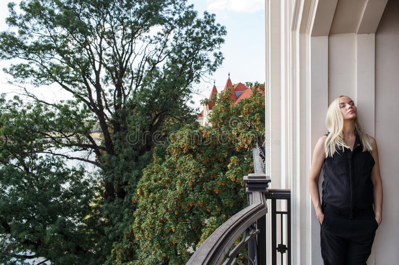 Portrait of the pregnant woman on the balcony stock photos