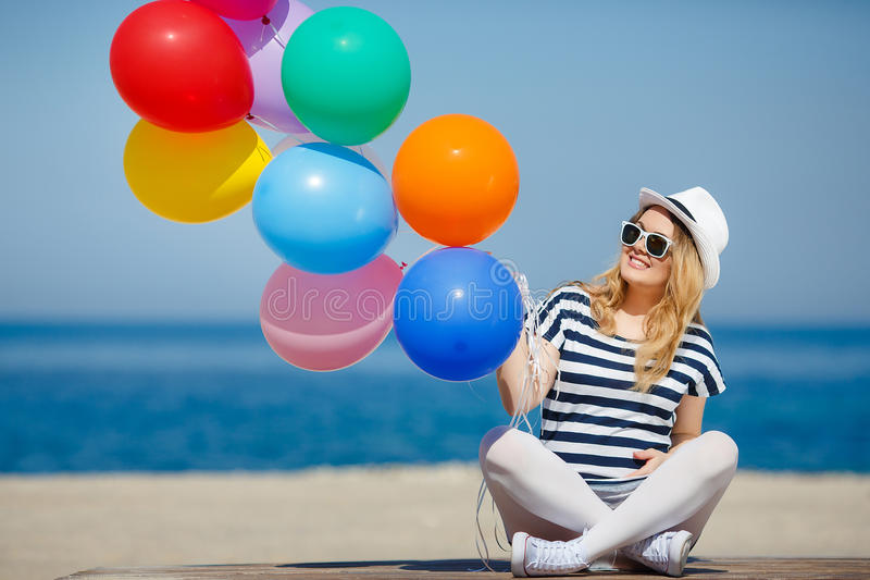 Portrait of pregnant woman with sunglasses and hat royalty free stock images