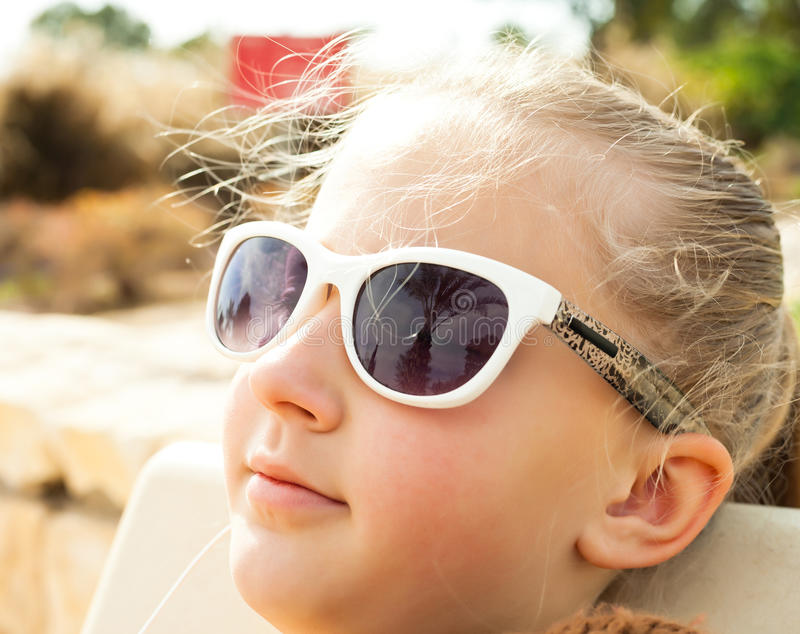 Portrait of a pretty blonde girl in glasses stock image