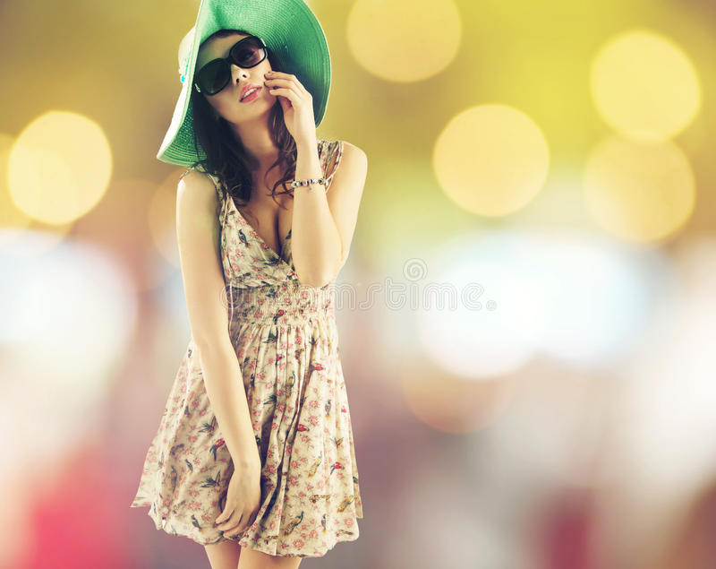 Portrait of pretty cheerful woman wearing hat royalty free stock photography