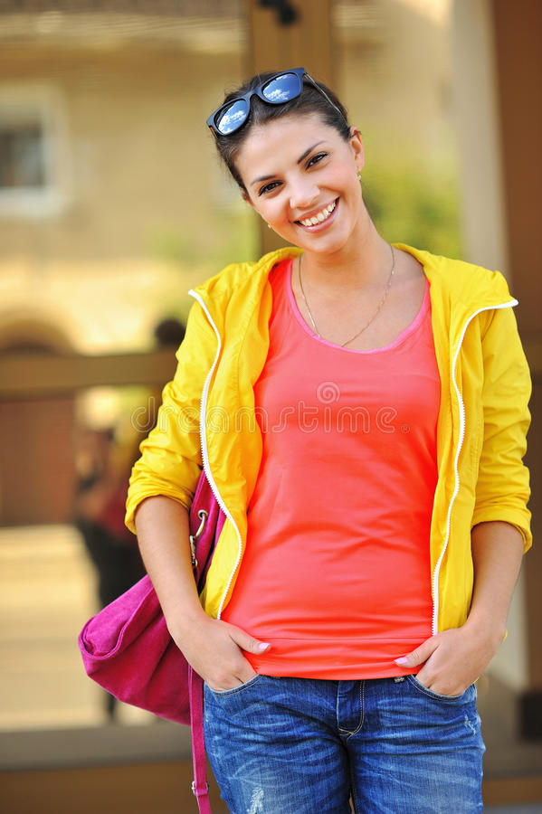 Portrait of pretty cheerful young woman stock photo