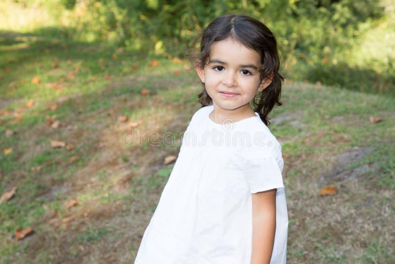 Portrait pretty child girl in home garden royalty free stock photo