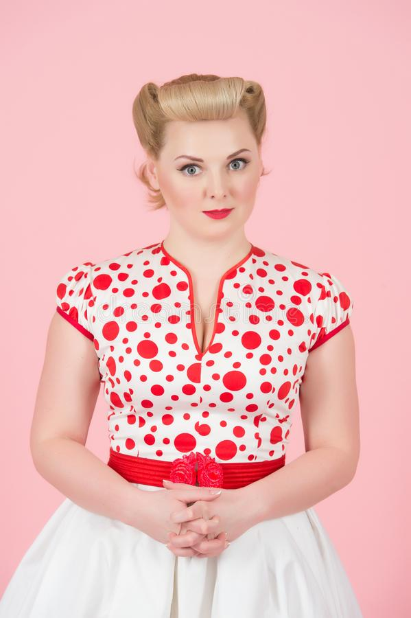 Portrait of pretty girl with blonde curls in pin-up style. stock photo