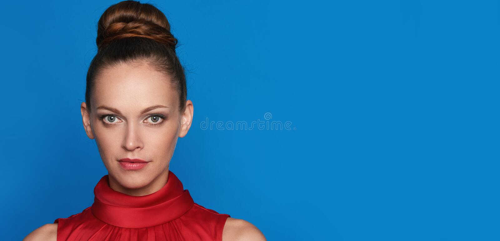 Portrait of pretty girl over blue background stock photos