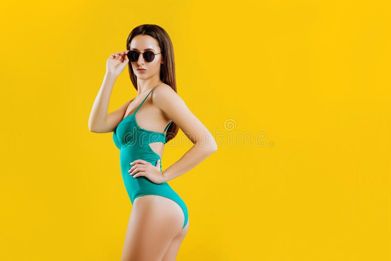 Pretty girl over yellow background. royalty free stock photo