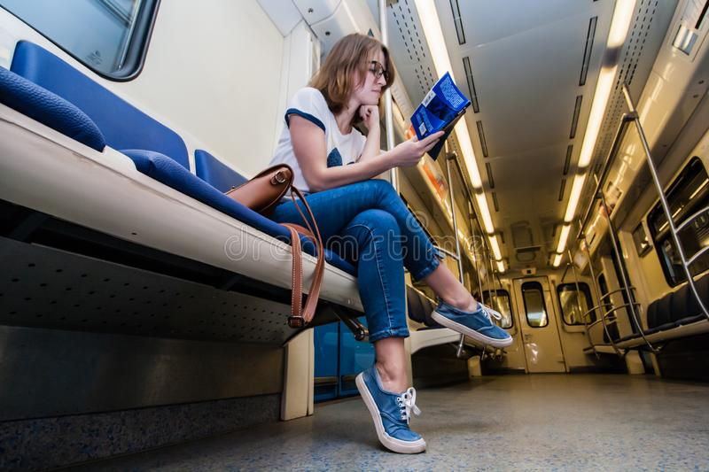 Portrait of young woman tourist in metro waggon royalty free stock photos
