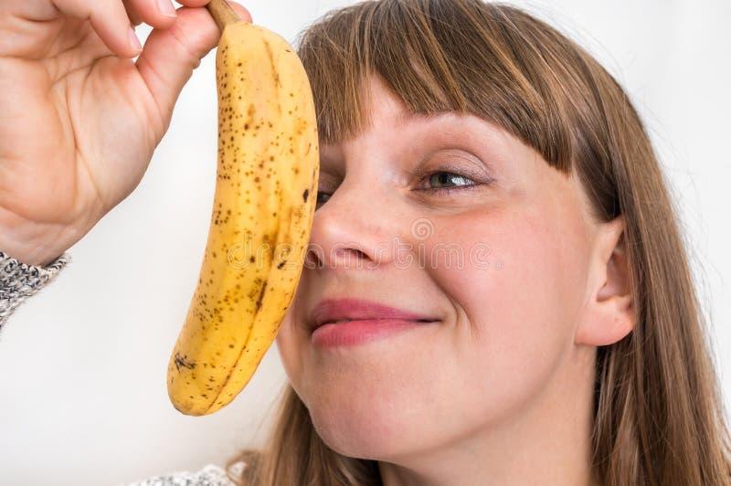 Portrait of pretty girl with yellow banana stock photos