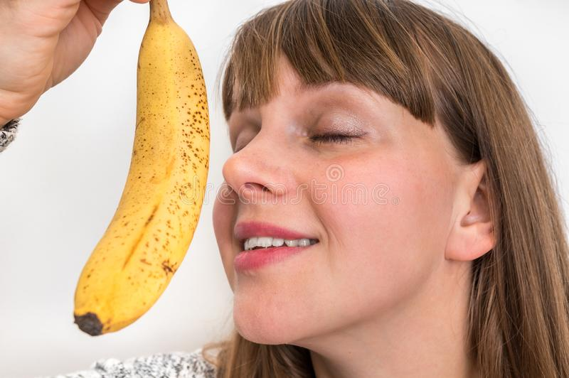 Portrait of pretty girl with yellow banana stock image