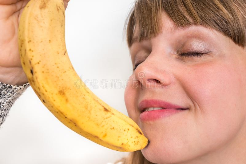 Portrait of pretty girl with yellow banana royalty free stock photography