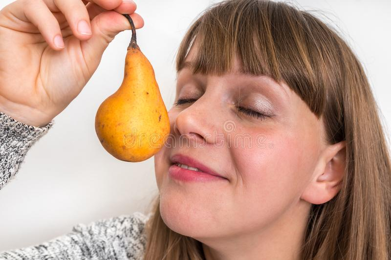 Portrait of pretty girl with yellow pear stock photo