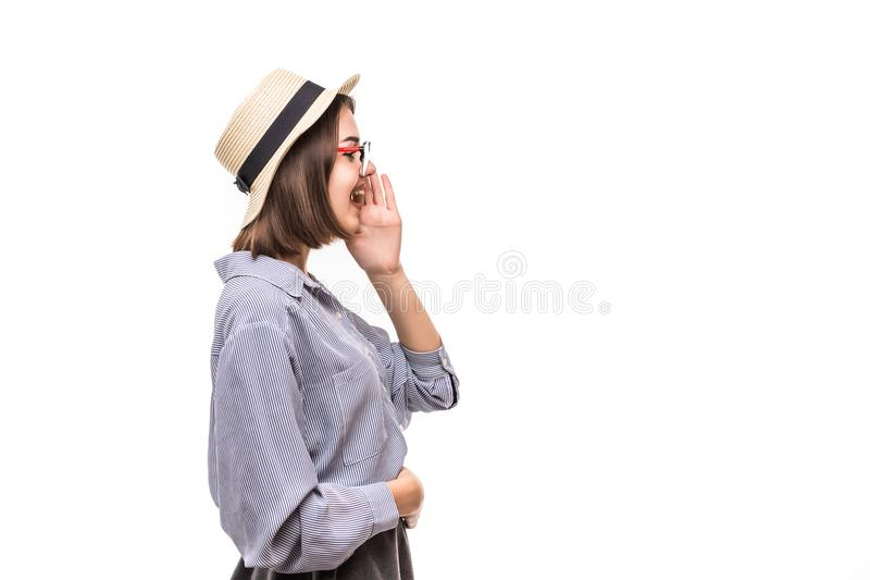 Portrait of pretty joyful girl in straw hat shouting in studio over white background. royalty free stock photos