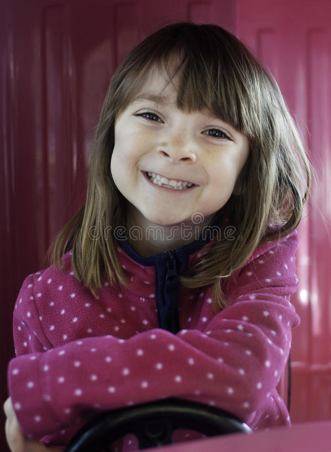 Portrait of a pretty little girl with bright smil stock images