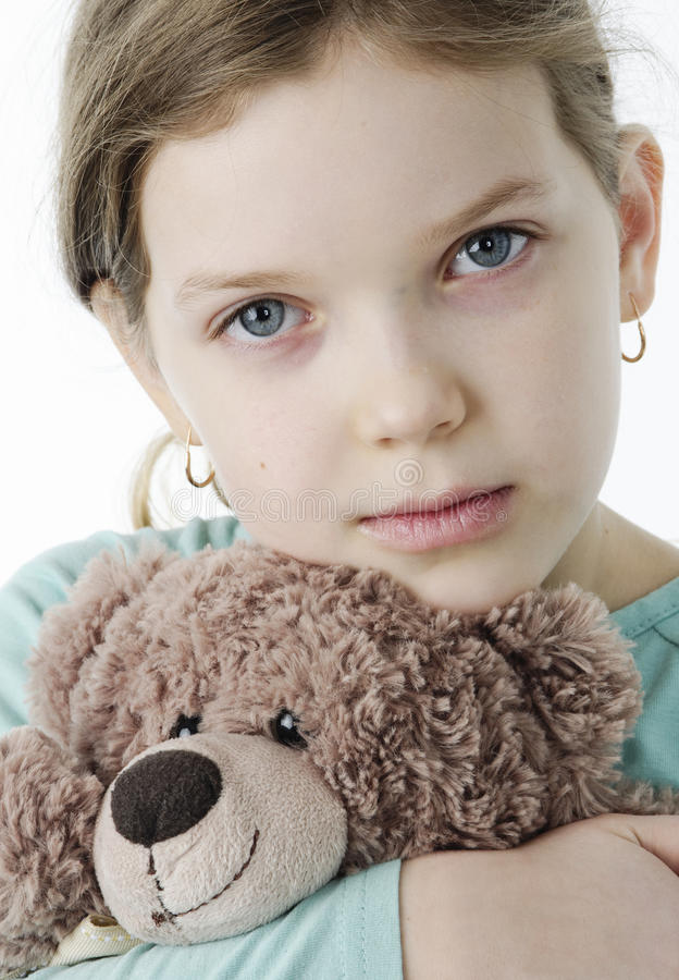 Portrait of pretty little girl holding teddy bear on white stock images
