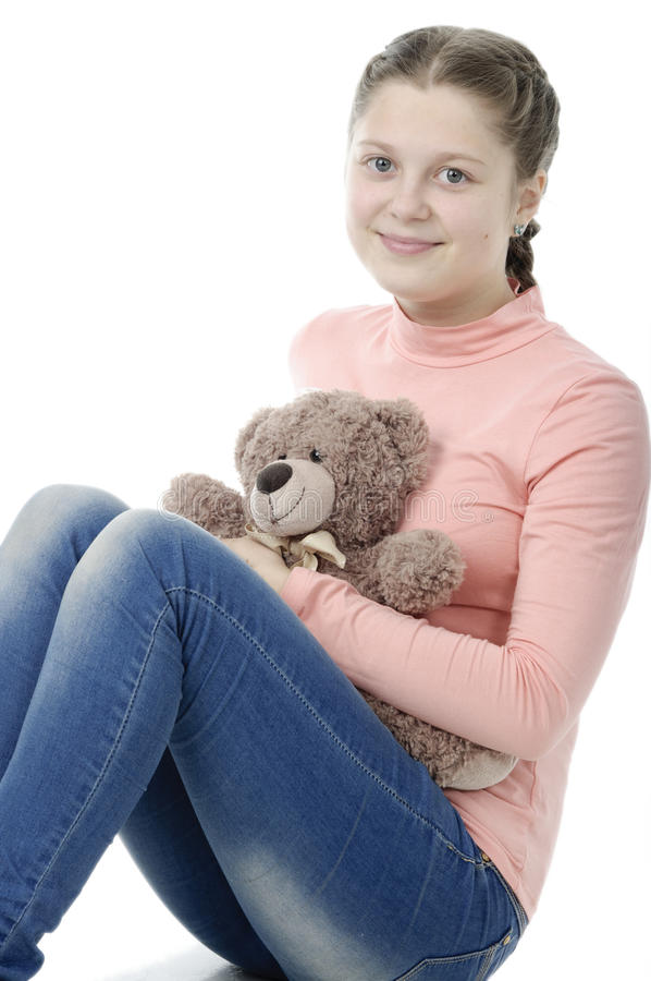 Portrait of pretty little girl holding teddy bear on white royalty free stock photo