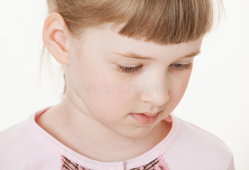 Portrait of a pretty little girl. White background royalty free stock image