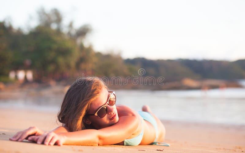 Portrait of pretty long haired woman in bikini having fun at tropical beach. Khao Lak, Thailand stock images