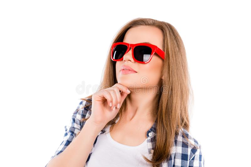 Portrait of pretty minded woman in red glasses touching chin royalty free stock photo