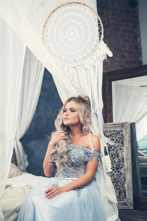 Portrait of pretty model girl dreaming at home. Romantic beauty royalty free stock photos