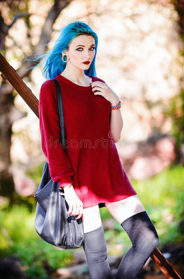 Portrait of pretty rock girl with blue hair royalty free stock photos