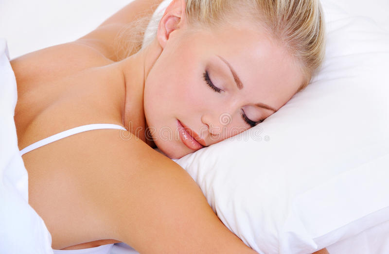 Portrait of pretty sleeping beautiful young woman stock photography