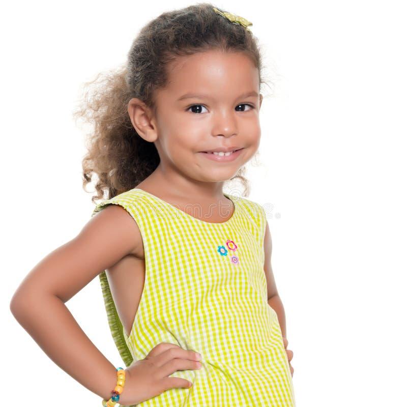Portrait of a pretty small hispanic girl smiling royalty free stock photo