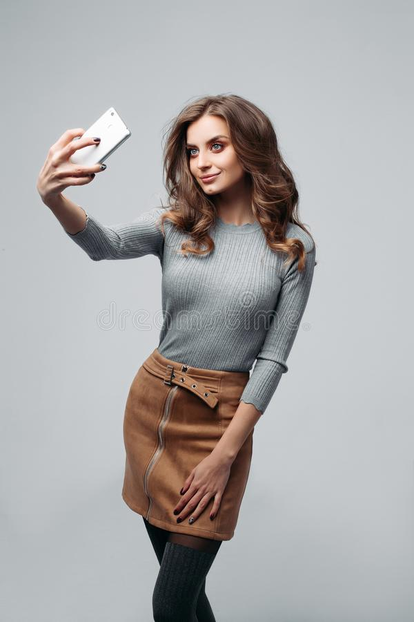 Attractive young woman taking selfie stock image