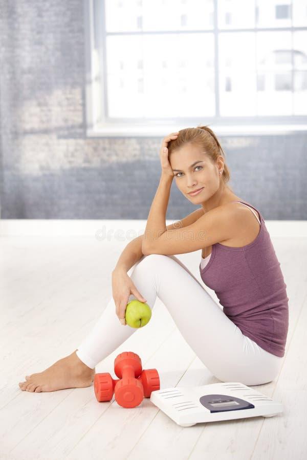 Portrait of pretty sporty girl in gym stock photo