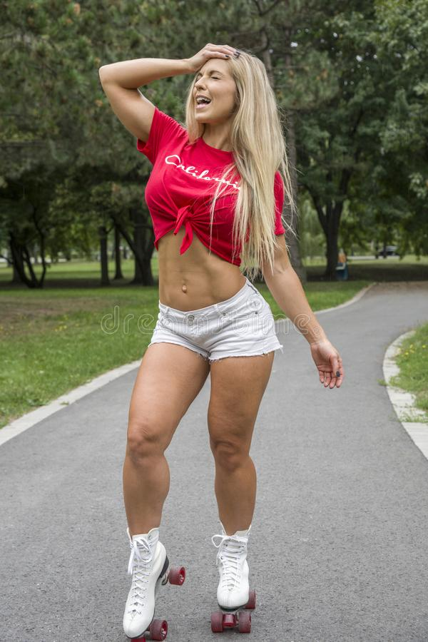 Picture of pretty sporty woman in roller skates stock images
