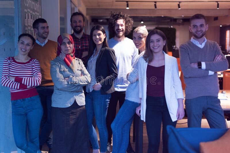 Portrait of pretty successful multi-ethnic corporate close-knit team concept, arabian european african ethnicity office workers. Pose look at camera four highly stock photography
