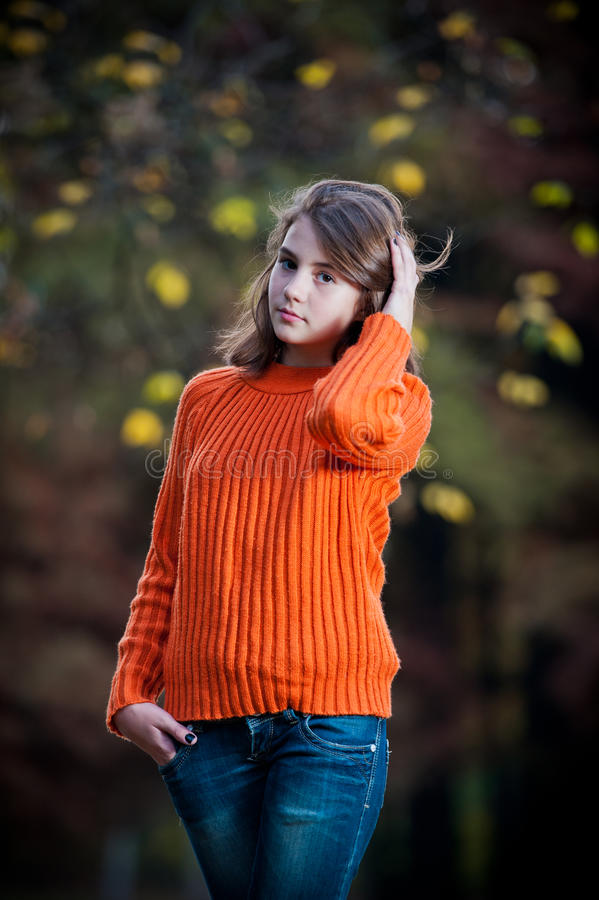 Portrait of pretty teen girl in autumn park stock photography