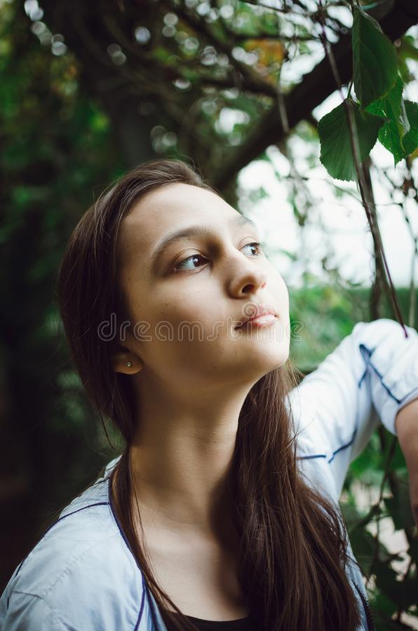 Portrait of a pretty teen girl on a background of nature. Close-up stock photo