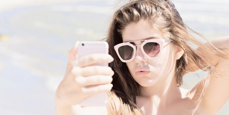 Portrait of a pretty teenage girl with long hair and sunglasses royalty free stock images