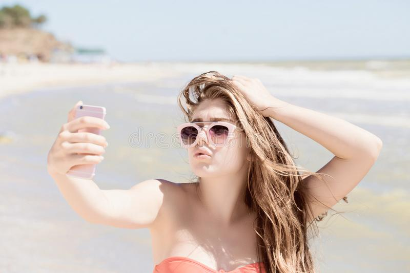 Portrait of a pretty teenage girl with long hair and sunglasses stock images