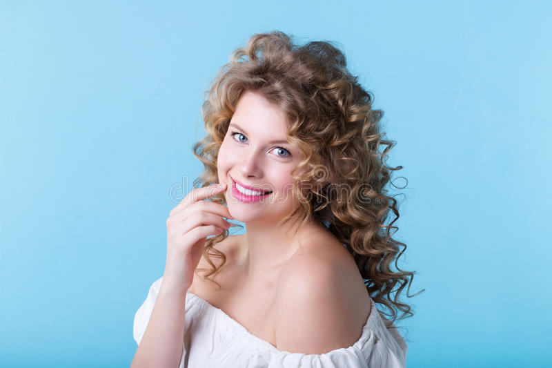 Portrait of pretty woman on a blue background. stock photo