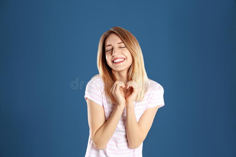 Portrait of pretty woman making heart with her hands royalty free stock images
