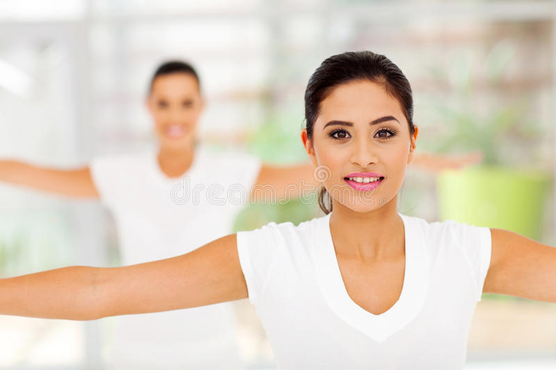 Pretty women stretching. Portrait of pretty women stretching arms stock images
