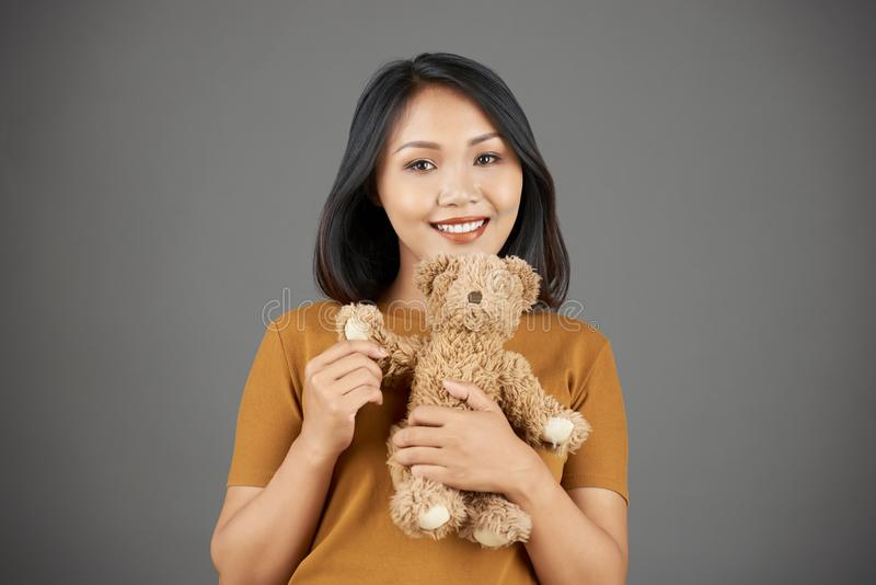 Happy woman with teddy bear stock image