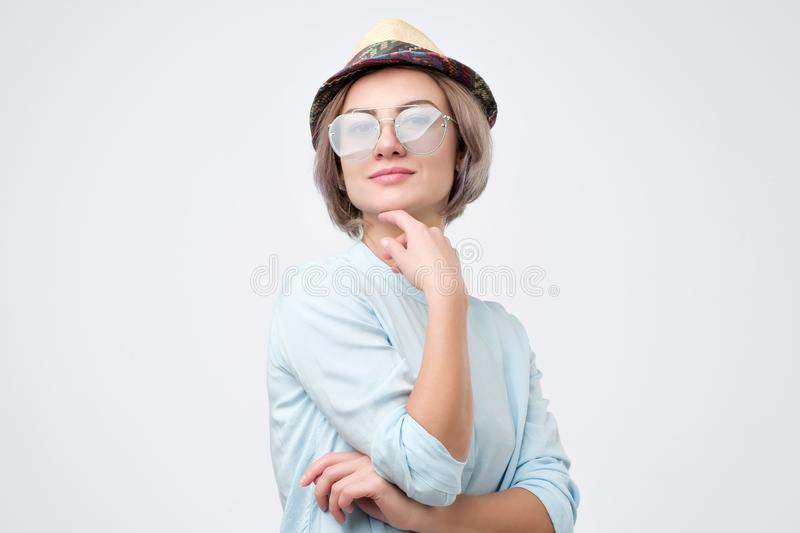 Portrait of pretty young caucasian woman in sunglasses and hat stock photos