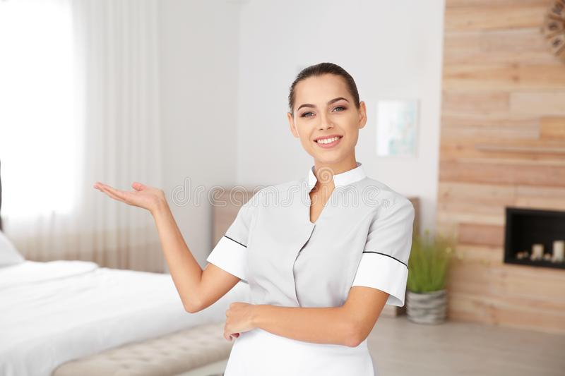 Portrait of pretty young chambermaid royalty free stock photo