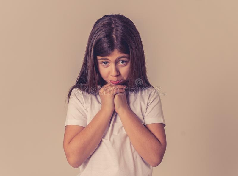 Young unhappy little girl making cute sad facial expression stock images