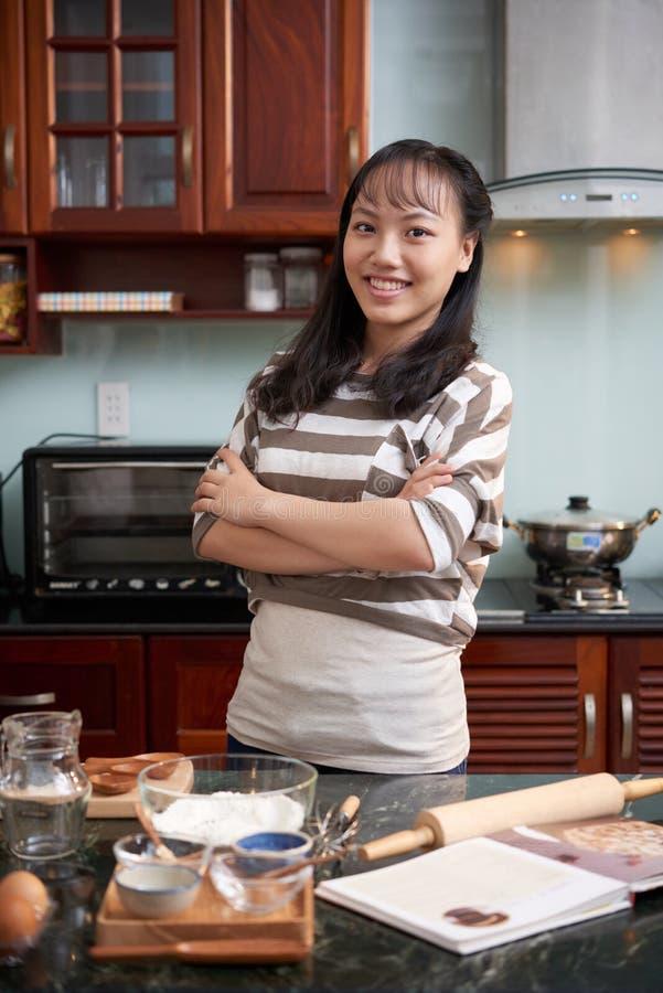 Teenage girl in kitchen royalty free stock image