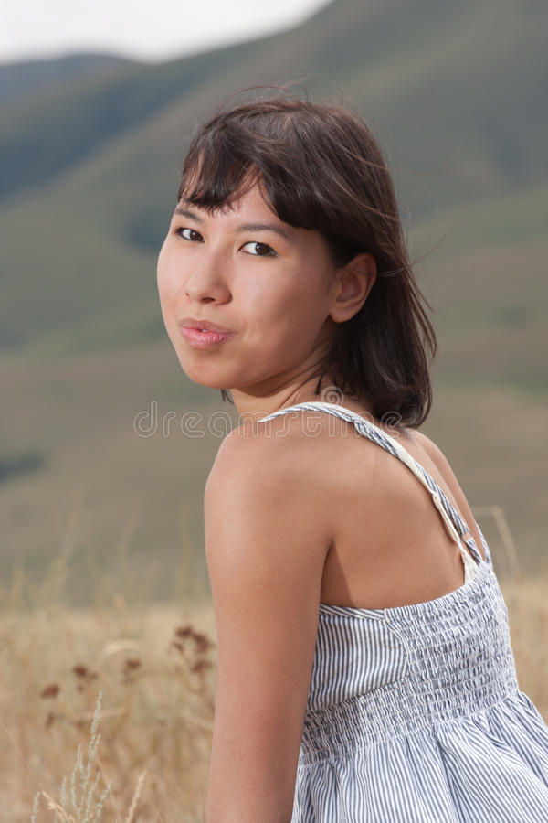 Download Portrait Of A Pretty Young Lady On A Meadow Hills Royalty Free Stock Photography - Image: 23894677