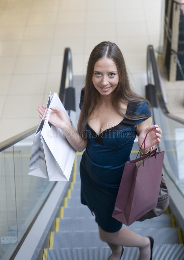 Download Portrait Of Pretty Young Woman With Bags In The Shop Stock Photo - Image of happiness, gifts: 31986388